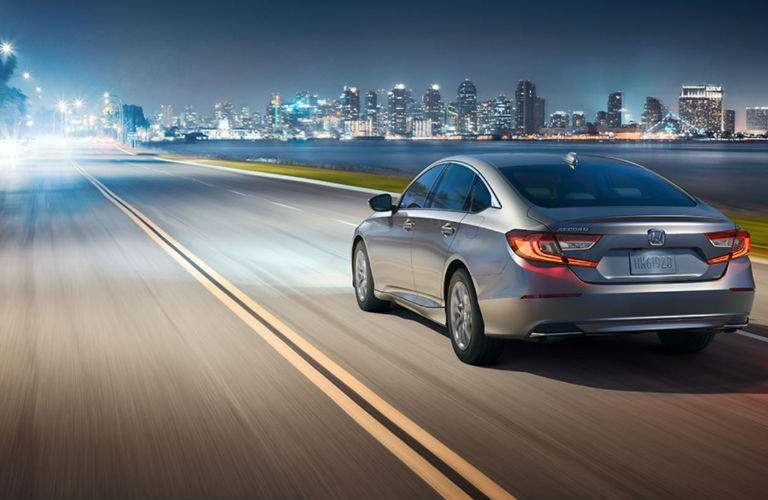 2018 Honda Accord Sedan driving at dusk to the city