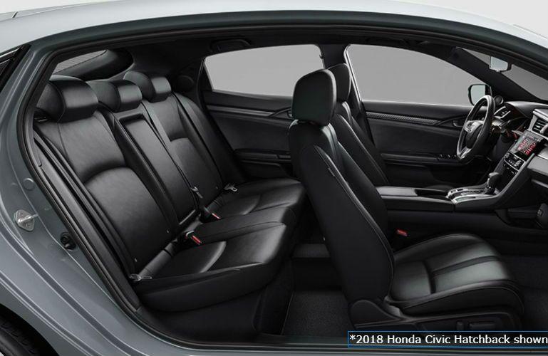 2018 Honda Civic Hatchback profile view of black leatherette seating