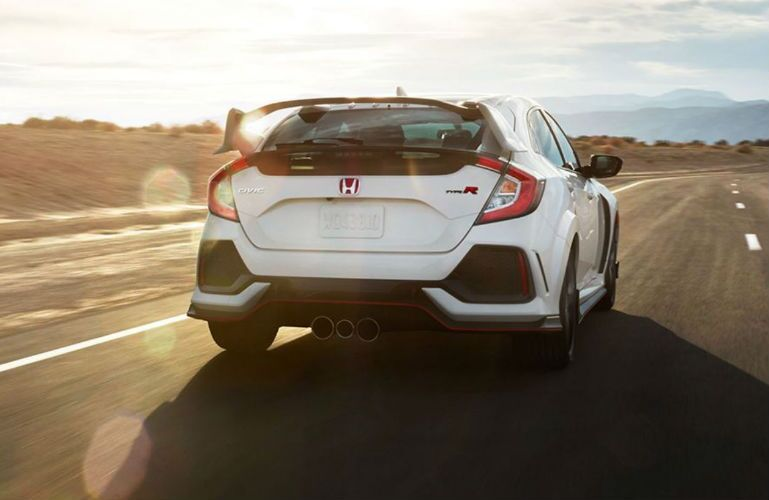 2018 Honda Civic Type R view of rear end as it drives on a road