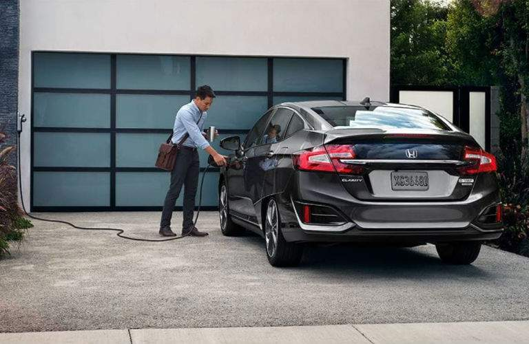 man charging his 2018 Honda Clarity Plug-in Hybrid