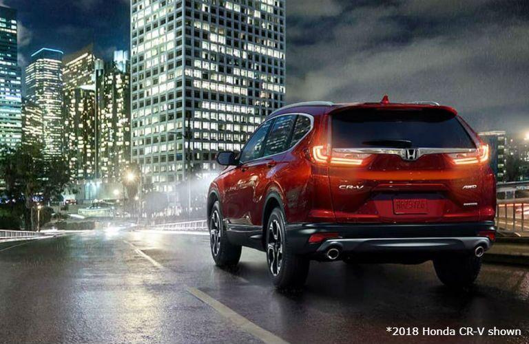 2018 Honda CR-V driving into a city at night