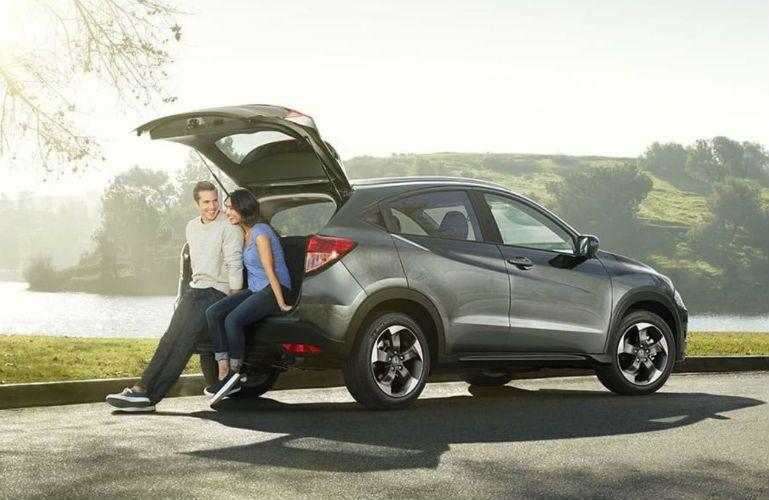 2018 Honda HR-V couple sitting on tailgate