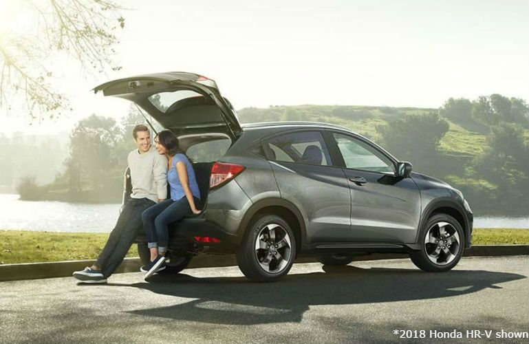 2018 Honda HR-V with couple sitting on tailgate
