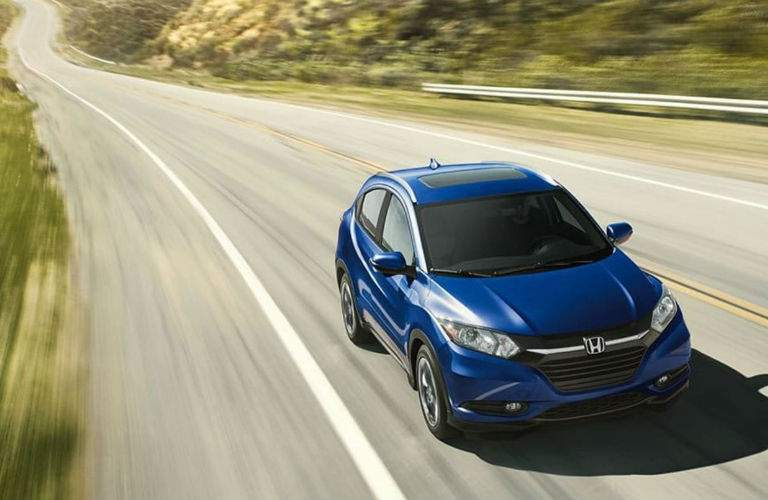 2018 Honda HR-V in blue driving fast