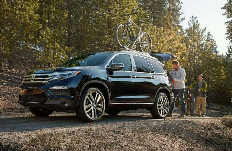 2018 Honda Pilot on a bike trail with a family