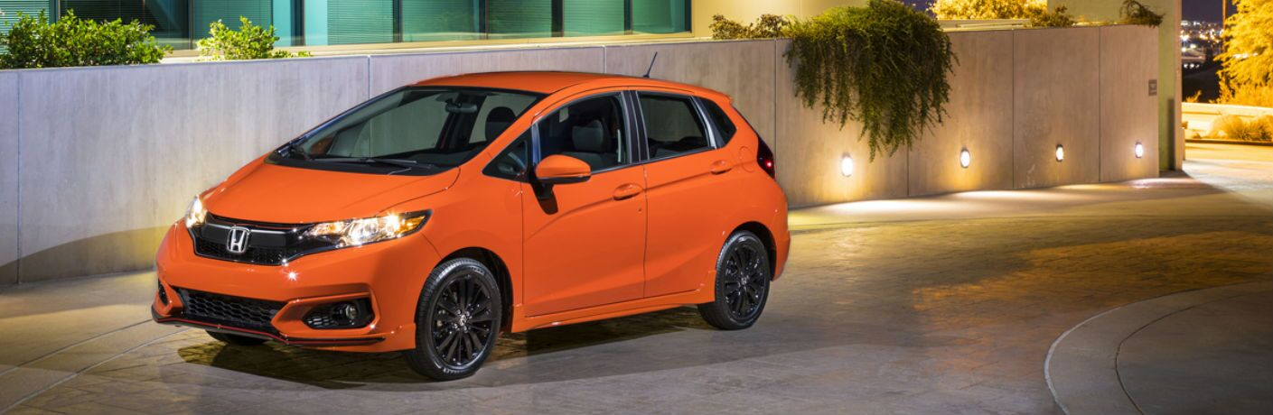 2019 Honda Fit parked by a building at night
