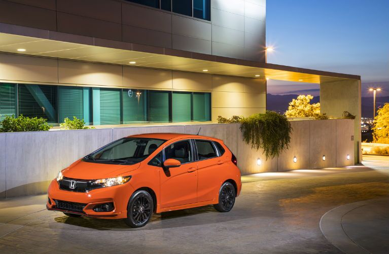 2019 Honda Fit in Orange Fury parked by a building at night