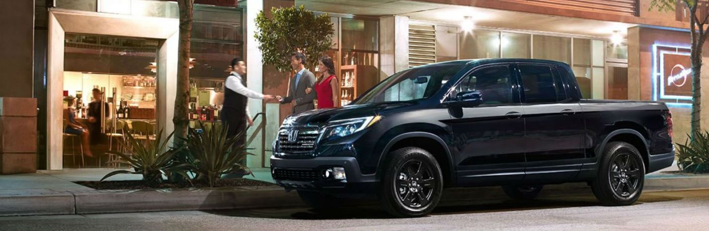 2019 Honda Ridgeline Black Edition parked outside of a restaurant