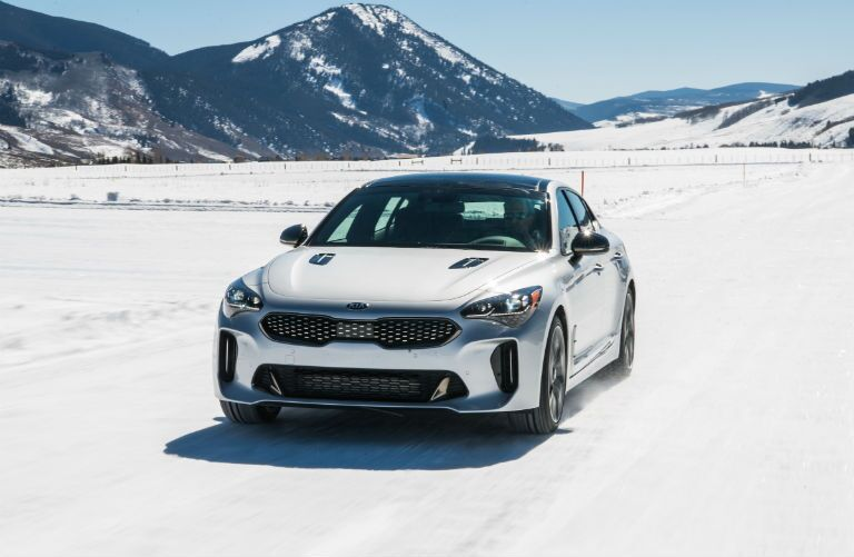 2019 Kia Stinger driving on snow
