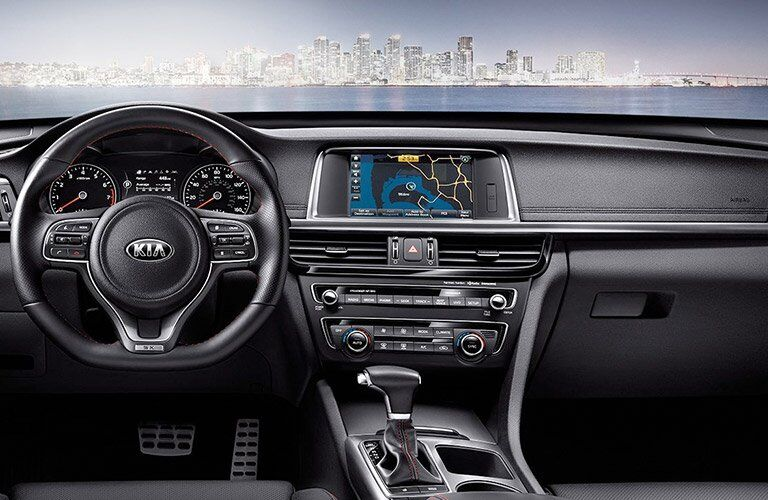 view of the 2017 Kia Optima interior front steering wheel and center console