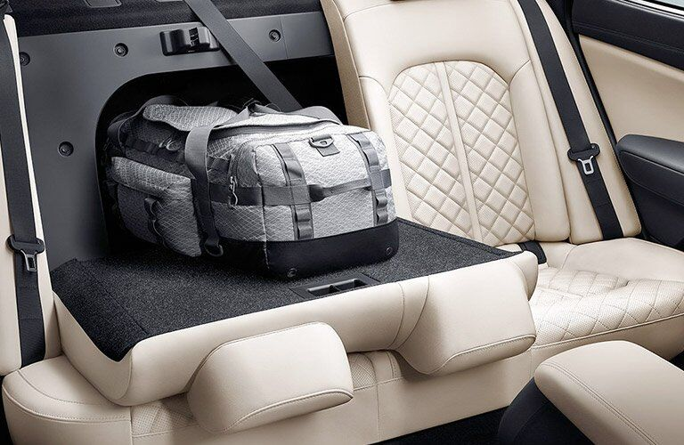 view of the 2017 Kia Optima cargo area with the second row seat folded down