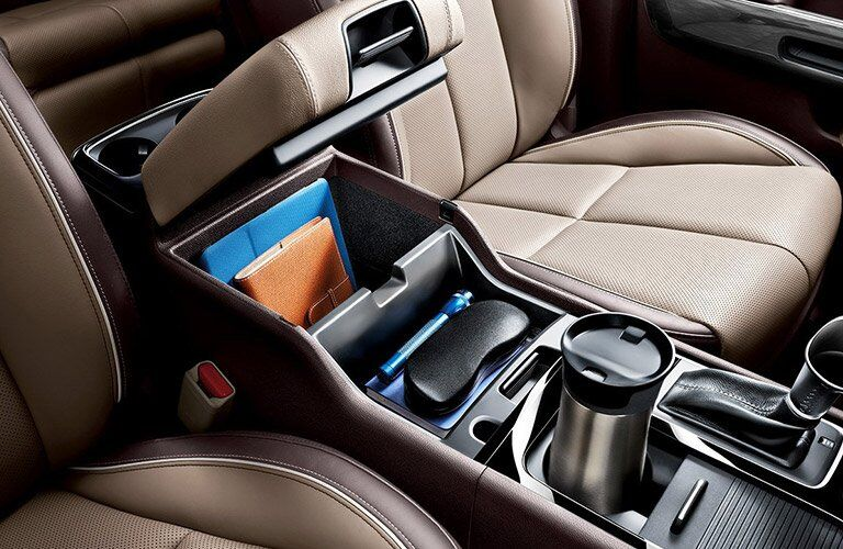 2017 Kia Sedona interior center armrest storage and cupholder