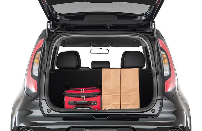 rear cargo space of 2018 kia soul with liftgate open and luggage in