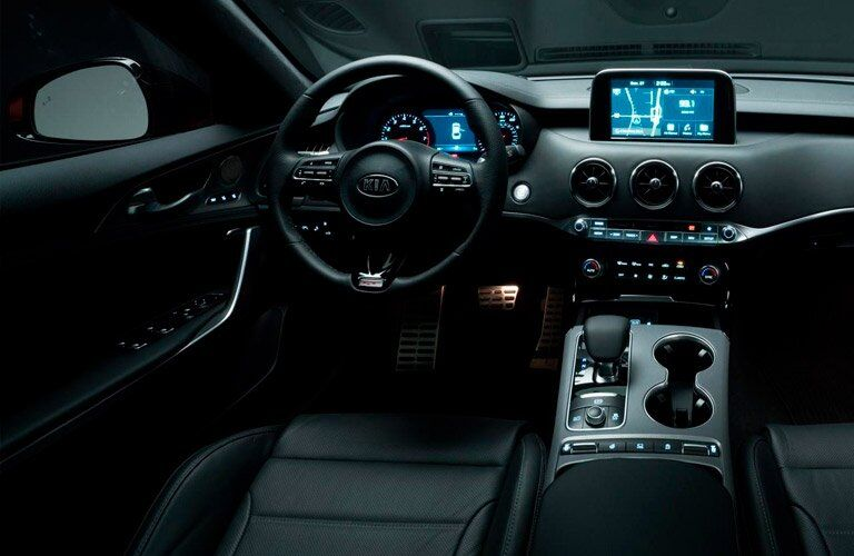 2018 Kia Stinger interior from driver's seat steering wheel and navigation