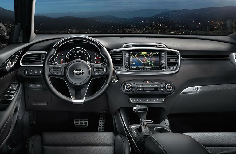 front interior of 2018 kia sorento including steering wheel and infotainment system