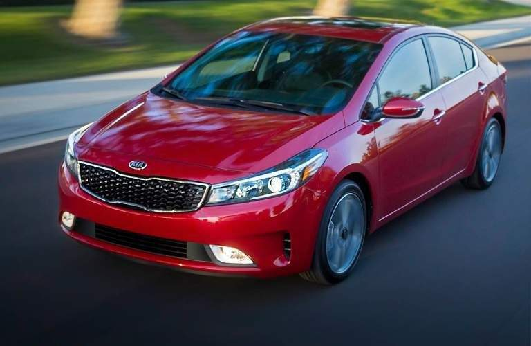view of the 2018 kia Forte in red driving