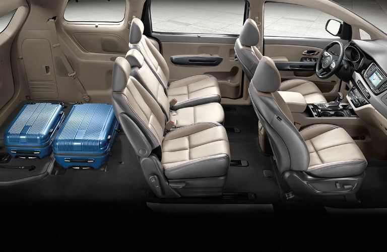 side aerial view of interior seats of 2018 kia sedona with third-row seating folded down for luggage
