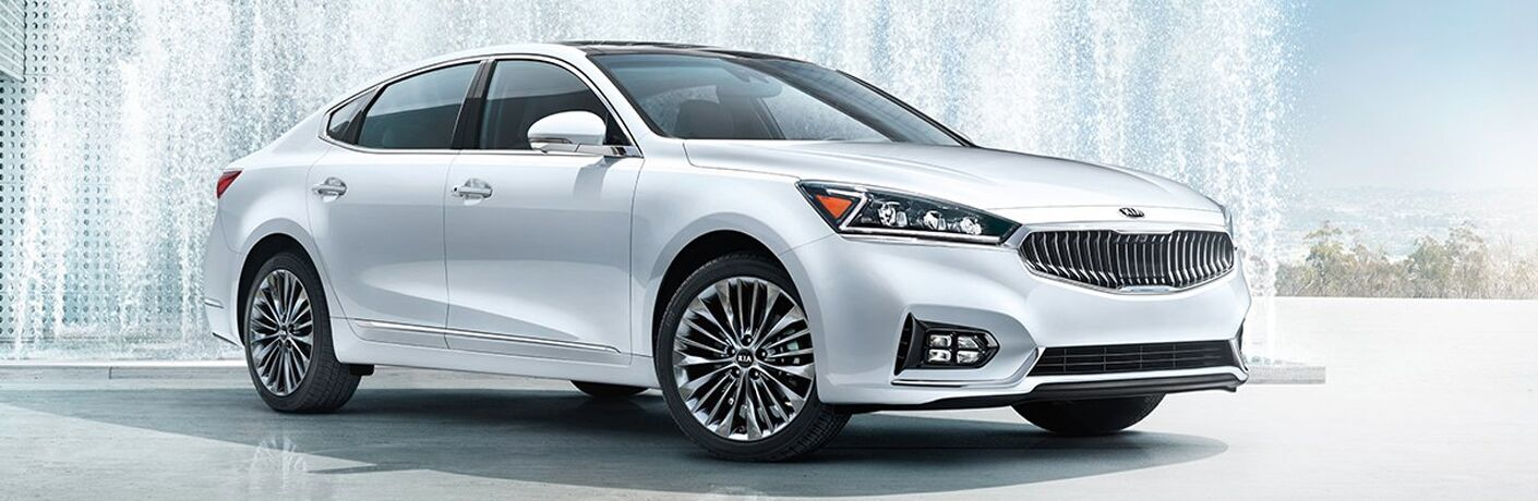 White 2019 Kia Cadenza parked in front of white structure