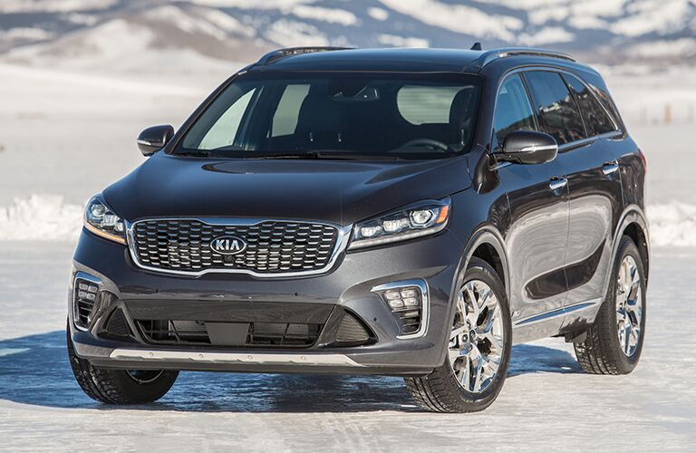 front view of blue 2019 kia sorento on snow road