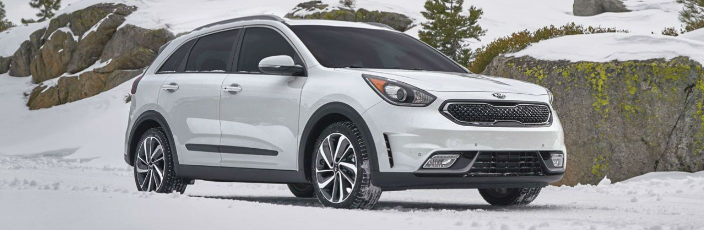 2019 Kia Niro parked in snow by rocks