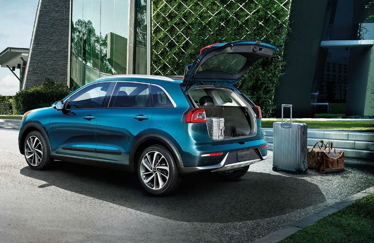 2019 Kia Niro with cargo door open and luggage next to it