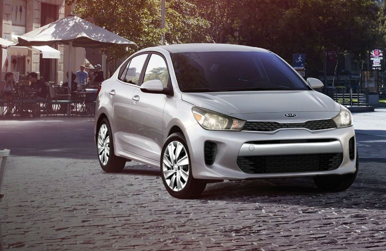 2019 Kia Rio parked by a park and people eating