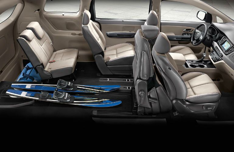 2019 Kia Sedona with aerial view of seating and seats folded for cargo room