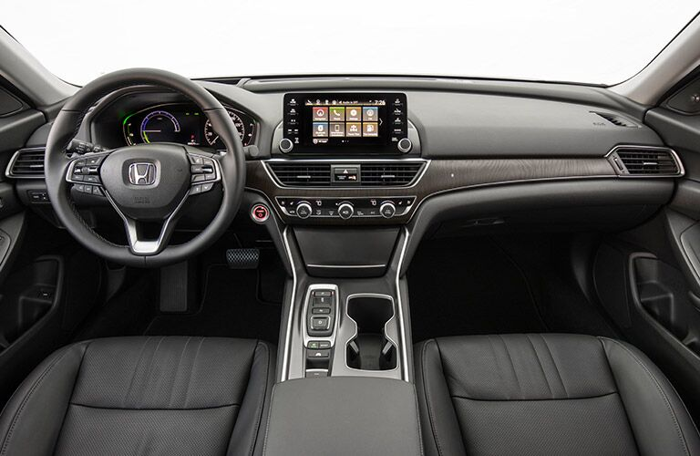 2018 Honda Accord Hybrid interior shot of front seating, steering wheel, dashboard infotainment screen, and transmission
