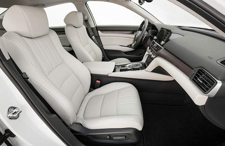 Interior of 2018 honda accord seen from passengers seat with legroom and headroom on display