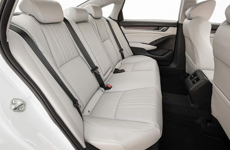 Rear seat row of 2018 honda accord shown with legroom and headroom emphasized
