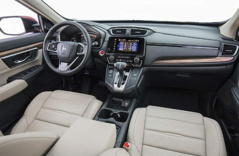 2018 Honda CR-V interior showing steering wheel and infotainment center shown in gray