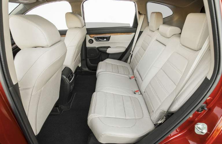 rear seat of 2018 honda cr-v shown with ample leg room and spacious headroom