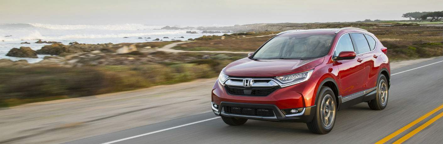 2018 Honda CR-V in red driving on beach road near atlantic city nj