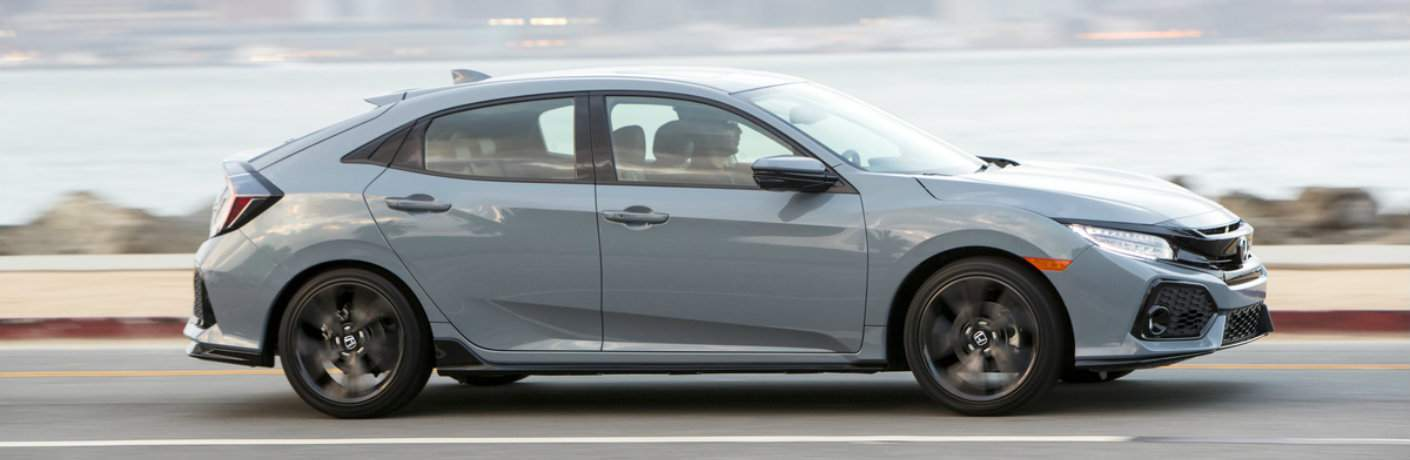 2018 honda civic hatchback shown driving on beach road near atlantic city, nj