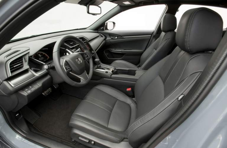 2018 honda civic hatchback interior with steering wheel front seat and infotainment system visible