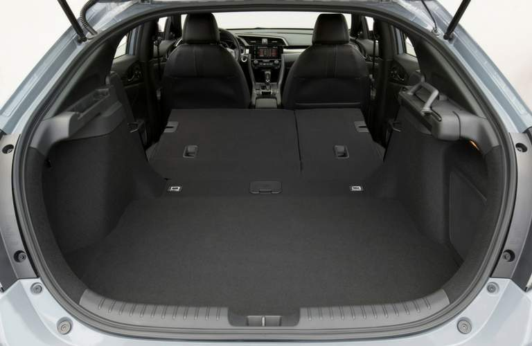 cargo space in the 2018 honda civic hatchback shown with rear gate open and seats down