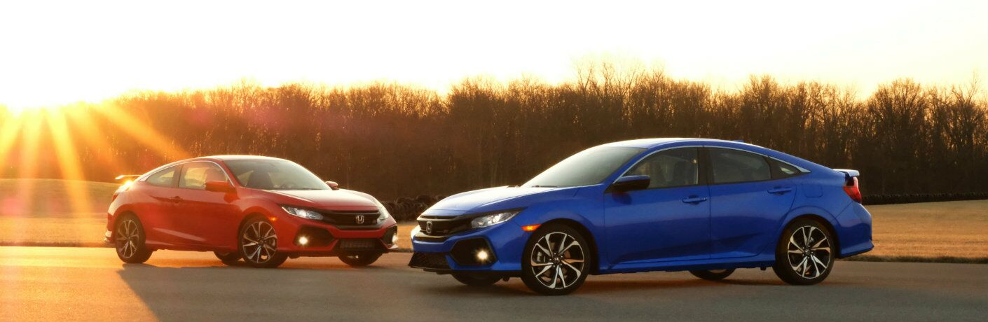 2018 Honda Civic models parked outside blue and red at sunset
