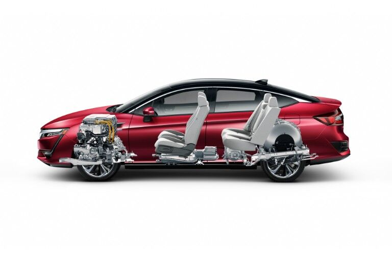 2018 Honda Clarity Fuel Cell exterior side shot with red paint color and interior view of hybrid fuel cell system and seating