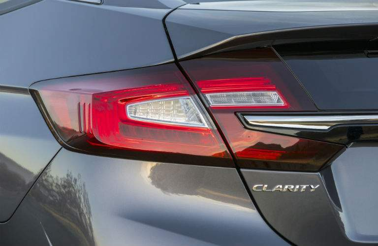 2018 Honda Clarity Plug-In Hybrid exterior closeup of back bumper headlight and Clarity badge