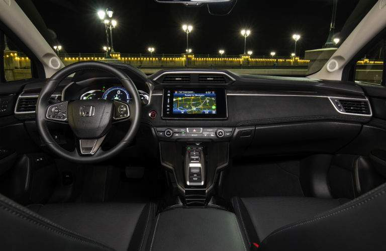 2018 Honda Clarity Plug-In Hybrid interior shot of front seating, steering wheel, and dashboard technology
