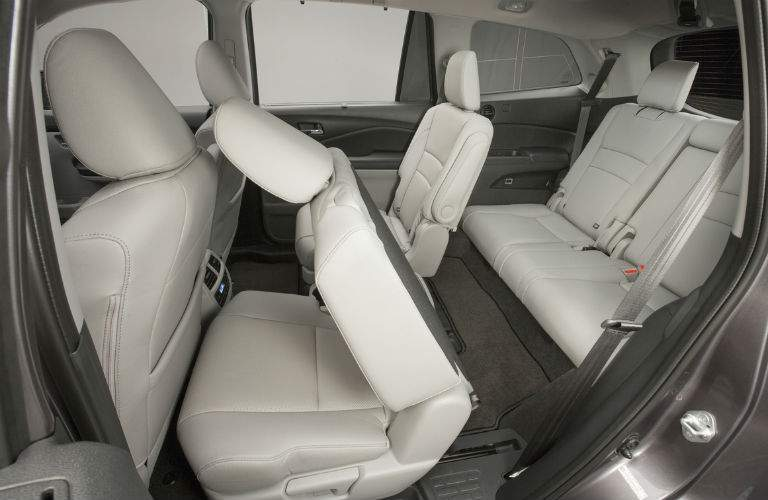 folding seat action shown interior of 2018 honda pilot with split 40/60 folding second row