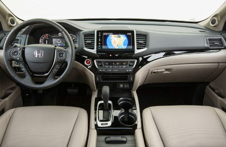 interior of 2018 honda ridgeline featuring infotainment system speakers and steering wheel