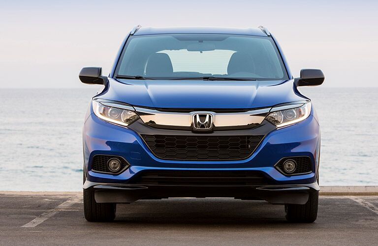 2019 Honda HR-V exterior front shot with blue paint color showing grille, headlights, and front bumper parked near the sea