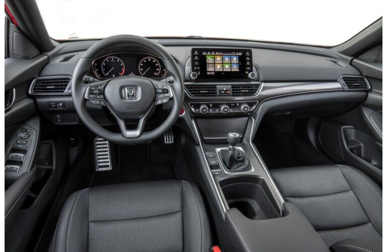 2019 Honda Accord Sport interior of front seating, steering wheel with logo badge, and dashboard layout and screens