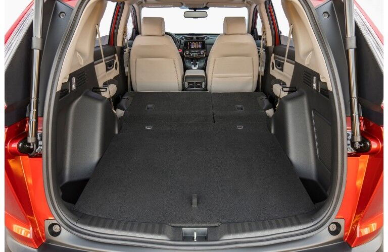 2019 Honda CR-V interior shot of trunk open and adjustable cargo space with seats folded down