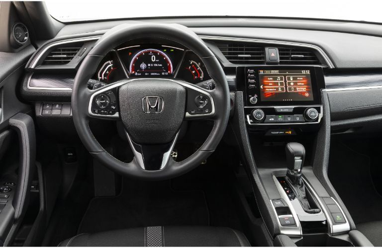 2019 Honda Civic Coupe interior shot of steering wheel, dashboard layout, transmission, and infotainment screen