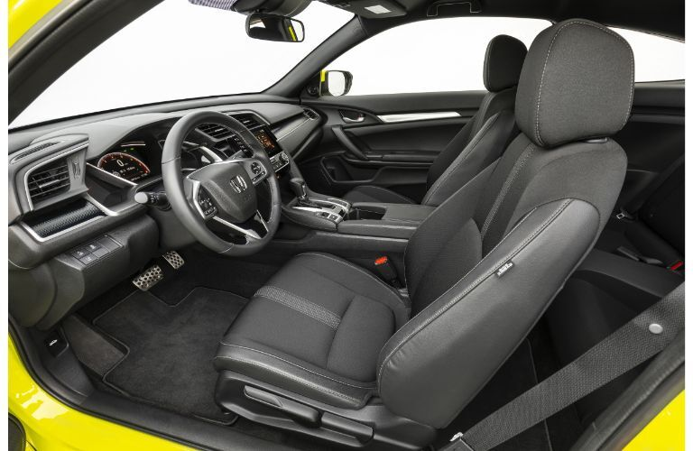 2019 Honda Civic Coupe interior side shot of seating upholstery and dashboard layout