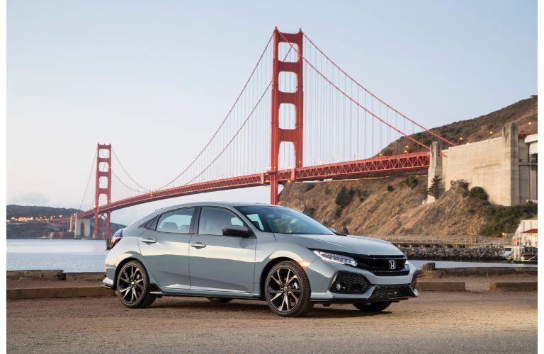 2019 Honda Civic Hatchback exterior shot with gray paint color parked near the golden gate bridge