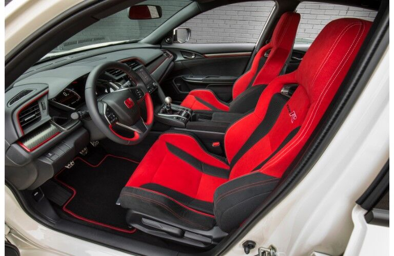 2019 Honda Civic Type R interior side shot of front sport seating, dashboard, and steering wheel