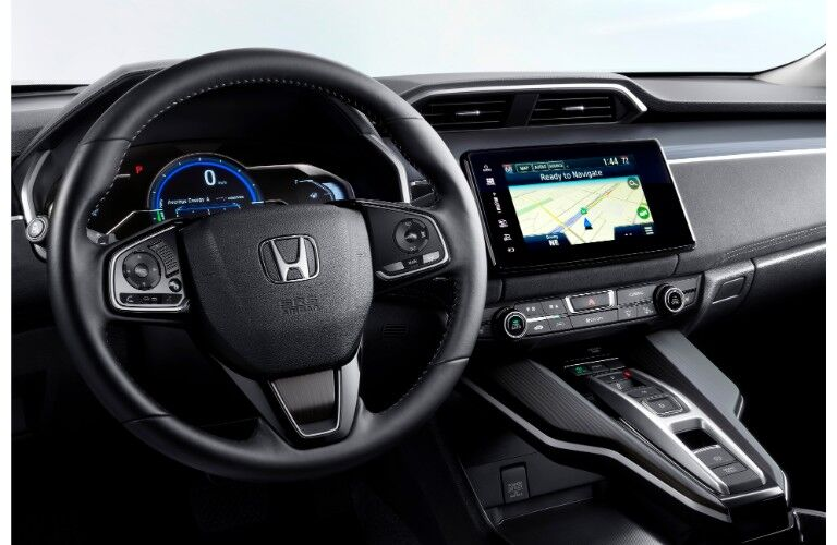 2019 Honda Clarity Electric interior closeup of sterring wheel, driving display, and dashboard infotainment screen layout